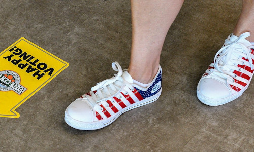A voter sports patriotic shoes in California. Election officials across the U.S. are also putting their sneakers to work as they hand-carry voting results to avoid cyber risks.